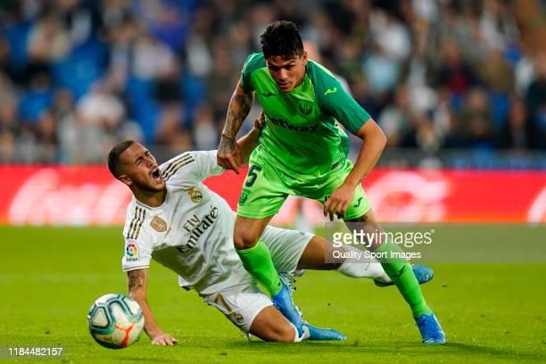Eden Hazard of Real Madrid battles for the ball Jonathan Silva of CD Leganes during the Liga match between Real Madrid CF and CD Leganes at Estadio...