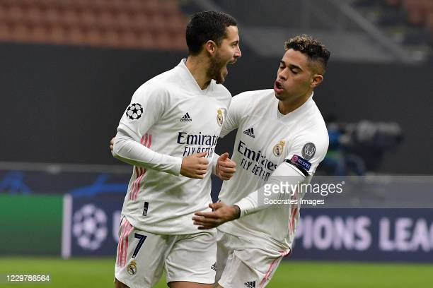 Eden Hazard of Real Madrid Celebrates 0-1 with Mariano Diaz of Real Madrid during the UEFA Champions League match between Internazionale v Real...