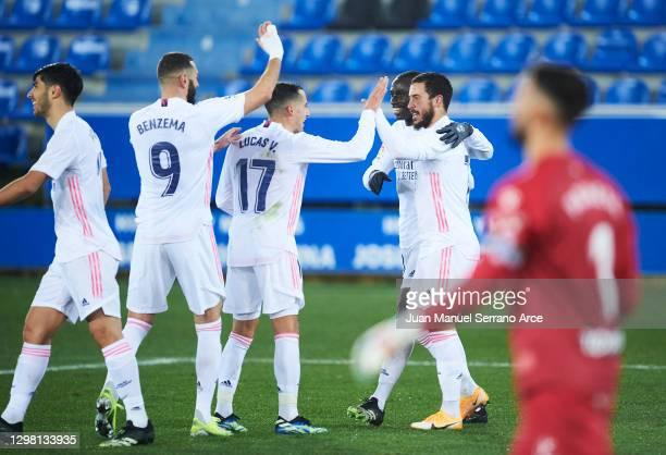 Eden Hazard of Real Madrid celebrates with his teammates Ferland Mendy, Lucas Vazquez and Karim Benzema of Real Madrid after scoring his team's third...
