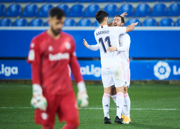 Eden Hazard of Real Madrid celebrates with his teammates Marco Asensio of Real Madrid after scoring his team's third goal during the La Liga...