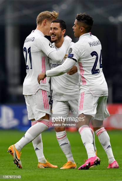 Eden Hazard of Real Madrid celebrates with Martin Oedegaard and Mariano after scoring their team's firs goal during the UEFA Champions League Group B...