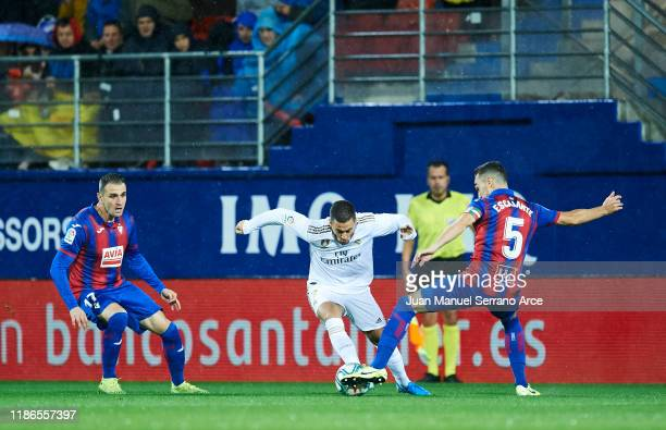 Eden Hazard of Real Madrid CF duels for the ball with Gonzalo Escalante of SD Eibar during the Liga match between SD Eibar SAD and Real Madrid CF at...