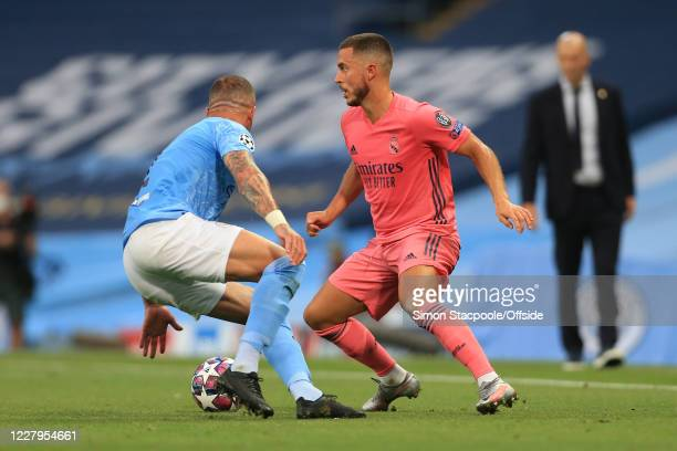 Eden Hazard of Real Madrid evades Kyle Walker of Man City during the UEFA Champions League round of 16 second leg match between Manchester City and...