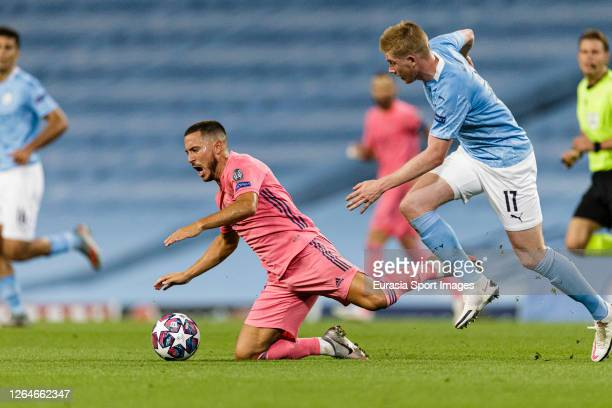 Eden Hazard of Real Madrid is challenged by Kevin De Bruyne of Manchester City during the UEFA Champions League round of 16 second leg match between...