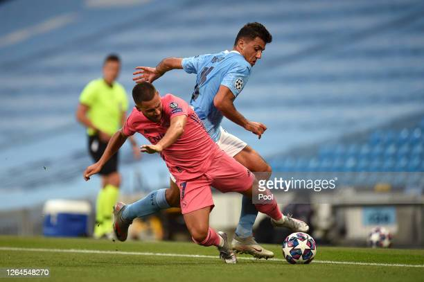 Eden Hazard of Real Madrid is challenged by Rodrigo of Manchester City during the UEFA Champions League round of 16 second leg match between...