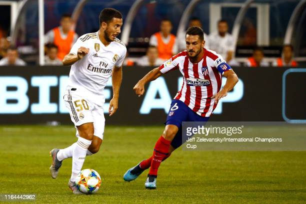 Eden Hazard of Real Madrid is defended by Jorge Resurreccion of Atletico Madrid during the International Champions Cup match at MetLife Stadium on...