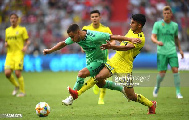 Eden Hazard of Real Madrid is tackled by Murat Saglam of Fenerbache during the Audi cup 2019 3rd place match between Real Madrid and Fenerbahce at...