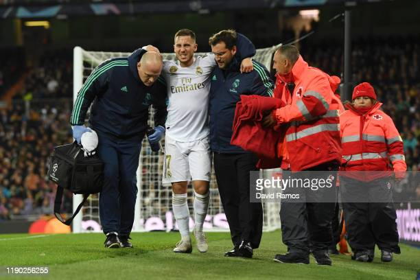 Eden Hazard of Real Madrid leaves the pitch with an injury during the UEFA Champions League group A match between Real Madrid and Paris SaintGermain...
