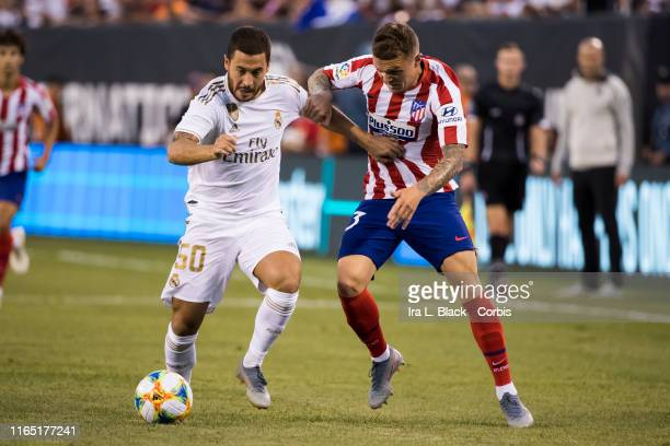Eden Hazard of Real Madrid mixes it up with Vitolo of Atletico Madrid during the International Champions Cup Friendly match between Atletico de...