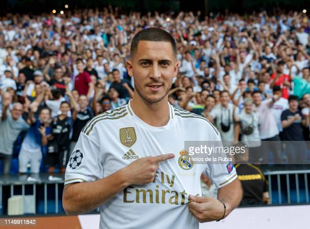 Eden Hazard of Real Madrid poses during his official presentation at Santiago Bernabeu stadium on June 12 2019 in Madrid Spain