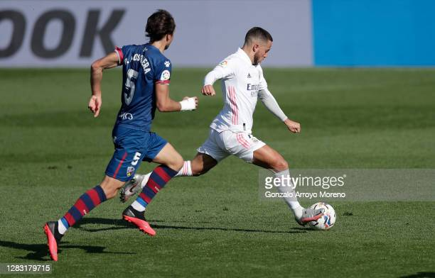 Eden Hazard of Real Madrid scores his team's first goal during the La Liga Santander match between Real Madrid and SD Huesca at Estadio Santiago...