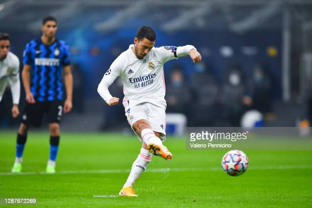 Eden Hazard of Real Madrid scores their team's first goal from the penalty spot during the UEFA Champions League Group B stage match between FC...