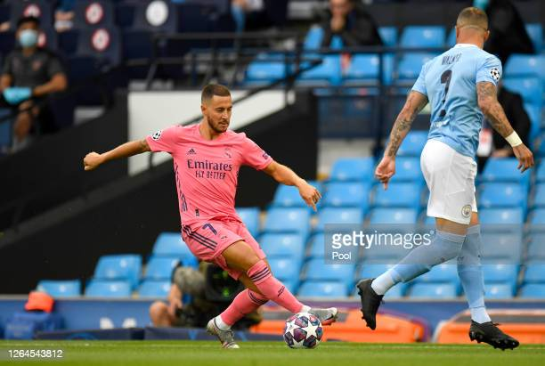 Eden Hazard of Real Madrid takes on Kyle Walker of Manchester City during the UEFA Champions League round of 16 second leg match between Manchester...