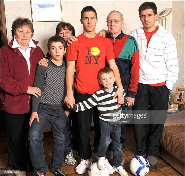 Eden Hazard poses at home with his family Nicole his grandmother Kylian his brother Carine his mother Ethan his brother Francis his grandfather and...