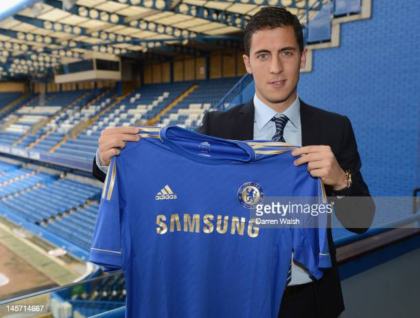 Eden Hazard poses with a team shirt after agreeing terms with Chelsea FC at Stamford Bridge on June 4, 2012 in London, England.