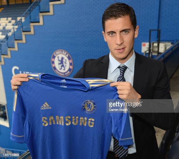 Eden Hazard poses with a team shirt after agreeing terms with Chelsea FC at Stamford Bridge on June 4 2012 in London England