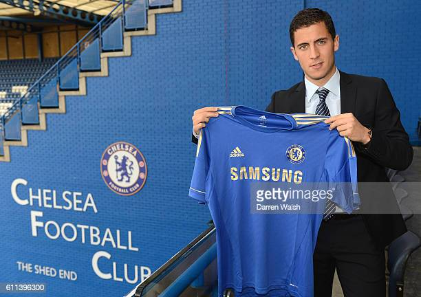 Eden Hazard poses with a team shirt after agreeing terms with Chelsea FC