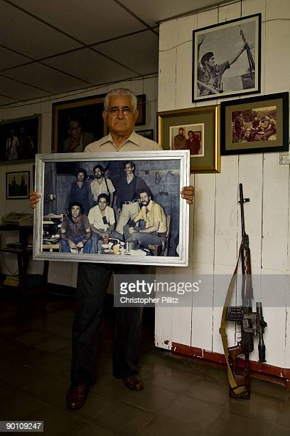 Eden Pastora also known as 'Comandante Cero' seen at home surrounded by photographs and weapons used during his years in combat including the image...