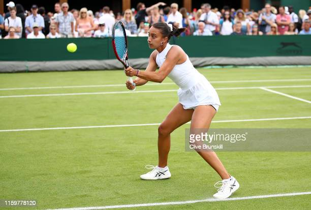 Eden Silva of Great Britain plays a backhand in their Ladies' Doubles first round match against Sorana Cirstea of Romania and Galina Voskoboeva of...