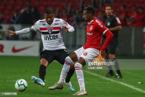 Edenilson of Internacional battles for the ball against Reinaldo of Sao Paulo during the match Internacional v Sao Paulo as part of Brasileirao...