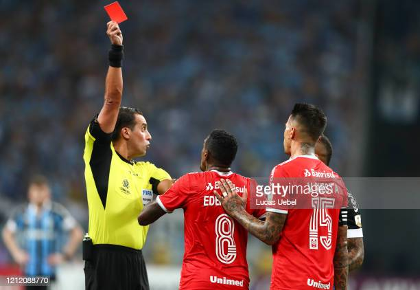 Edenilson of Internacional receives the red card from referee Fernando Rapallini during the match against Gremio for the Copa CONMEBOL Libertadores...