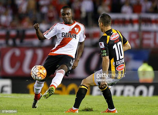 Eder Alvarez Balanta of River Plate fights for the ball with Pablo Escobar of The Strongest during a match between River Plate and The Strongest as...