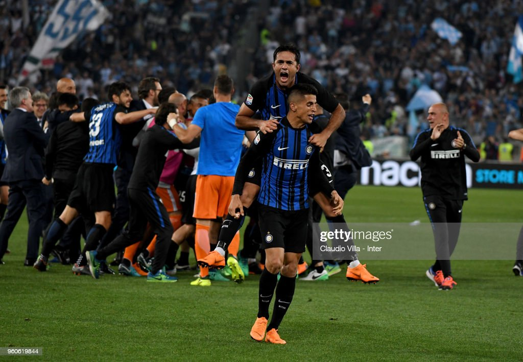 Eder and Joao Cancelo of FC Internazionale celebrate the victory and the qualification for the Champions League during the serie A match between SS Lazio and FC Internazionale at Stadio Olimpico on May 20, 2018 in Rome, Italy.