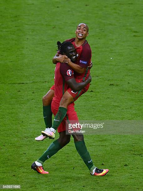 Eder and Joao Mario of Portugal celebrate winning after the UEFA EURO 2016 Final match between Portugal and France at Stade de France on July 10 2016...