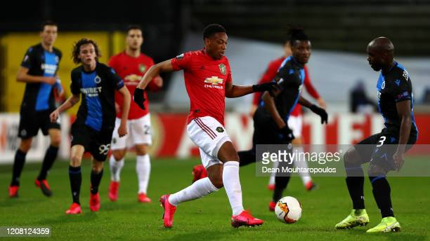 Eder Balanta of Club Brugge KV battles for the ball with Anthony Martial of Manchester United during the UEFA Europa League round of 16 first leg...