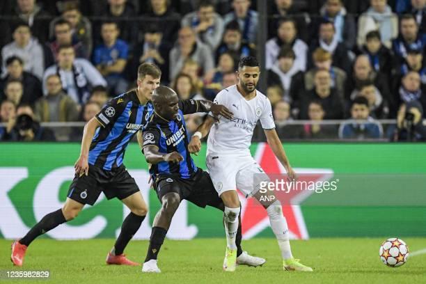 Eder Balanta of Club Brugge, Riyad Mahrez of Manchester City FC during the UEFA Champions League match between Club Brugge and Manchester City FC at...