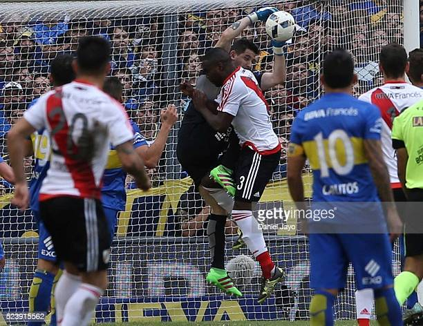 Eder Balanta of River Plate crashes into Agustin Orion of Boca Juniors during a match between Boca Juniors and River Plate as part of Torneo...