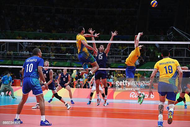 Eder Carbonera of Brazil spikes the ball during the Men's Gold Medal Match between Italy and Brazil on Day 16 of the Rio 2016 Olympic Games at...