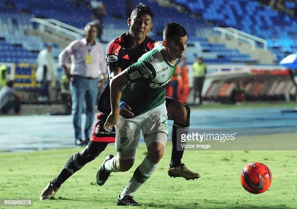 Eder Castaneda of America Cali struggles the ball with Nicolas Benedetti of Deportivo Cali during the match between America de Cali and Deportivo...
