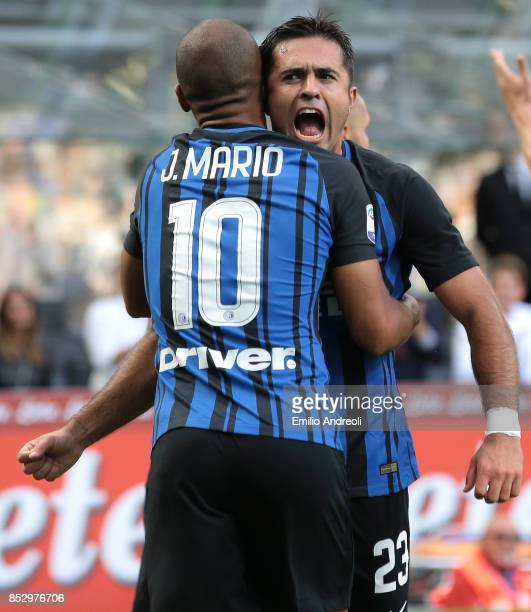 Eder Citadin Martins of FC Internazionale Milano celebrates the victory with his teammate Joao Mario at the end of the Serie A match between FC...