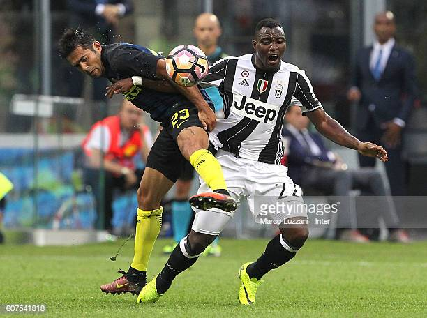 Eder Citadin Martins of FC Internazionale Milano competes for the ball with Kwadwo Asamoah of Juventus FC during the Serie A match between FC...