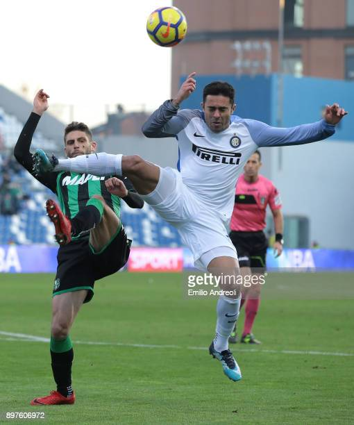 Eder Citadin Martins of FC Internazionale Milano competes for the ball with Domenico Berardi of US Sassuolo Calcio during the serie A match between...