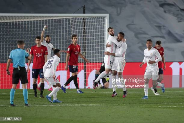 Eder Gabriel Militao of Real Madrid CF celebrates scoring their opening goal with teammates Nacho Fernández , Carlos Casemiro and Rodrygo Goes during...