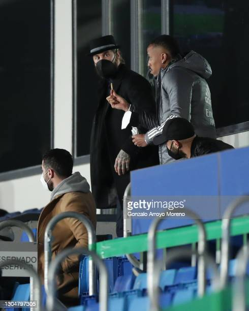 Eder Gabriel Militao of Real Madrid CF offer a snack to Sergio Ramos of Real Madrid CF during the La Liga Santander match between Real Madrid and...