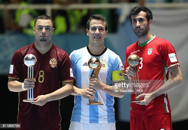 Eder Lima of Russia Fernando Wilhelm of Argentina and Ahmad Esmaeilpour of Iran are seen with their siver Gold and Bronze ball awards during the FIFA...