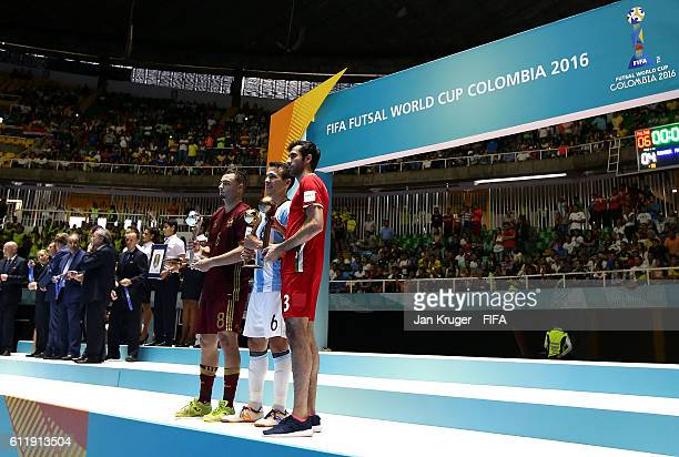 Eder Lima of Russia Fernando Wilhelm of Argentina and Ahmad Esmaeilpour of Iran pose with their awards during the FIFA Futsal World Cup final between...