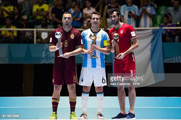 Eder Lima of Russia Fernando Wilhelm of Argentina and Ahmad Esmaeilpour of Iran pose with their Silver Gold and Bronze Ball awards after the FIFA...