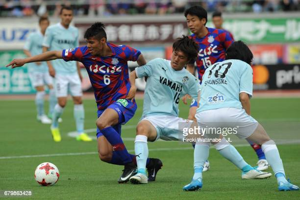 Eder Lima of Ventforet Kofu and Koki Ogawa of Jubilo Iwata compete for the ball during the JLeague J1 match between Ventforet Kofu and Jubilo Iwata...