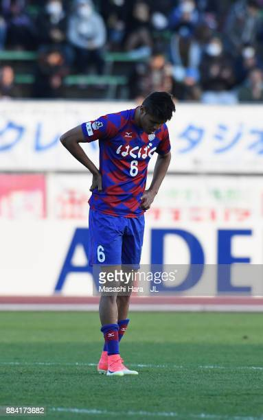 Eder Lima of Ventforet Kofu shows dejection after the relegation to the J2 despite his side's 1-0 victory in the J.League J1 match between Ventforet...