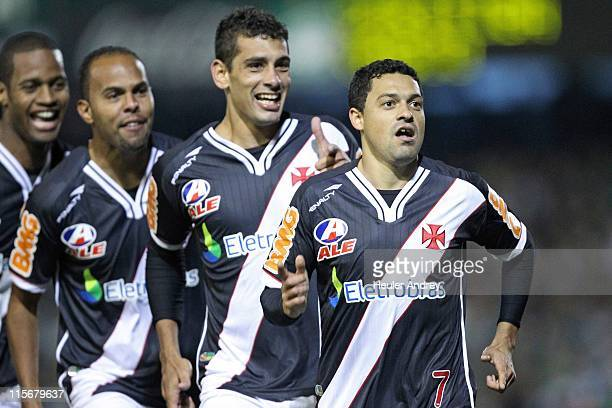 Eder Luis of Vasco celebrates with teammates a scored goal against Coritiba during a final match as part of the Brazil Cup 2011 at Couto Pereira...
