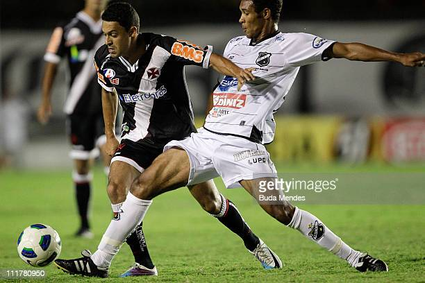 Eder Luis of Vasco struggles for the ball with a player of ABC during a match as part of Brazil Cup 2011 at Sao Januario stadium on April 06, 2011 in...