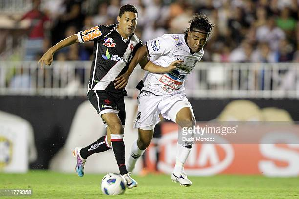 Eder Luis of Vasco struggles for the ball with Basilio of ABC during a match as part of Brazil Cup 2011 at Sao Januario stadium on April 06, 2011 in...