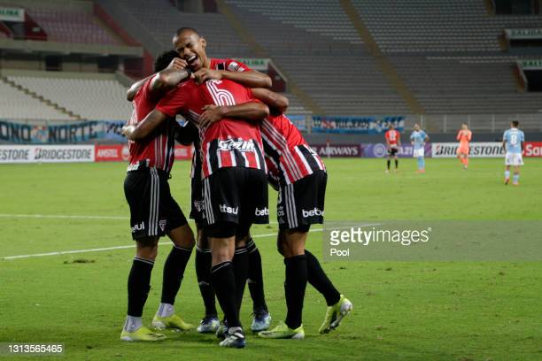 Eder Martins Citadin of Sao Paulo celebrates with teammates after scoring the third goal of his team during a match between Sporting Cristal and Sao...