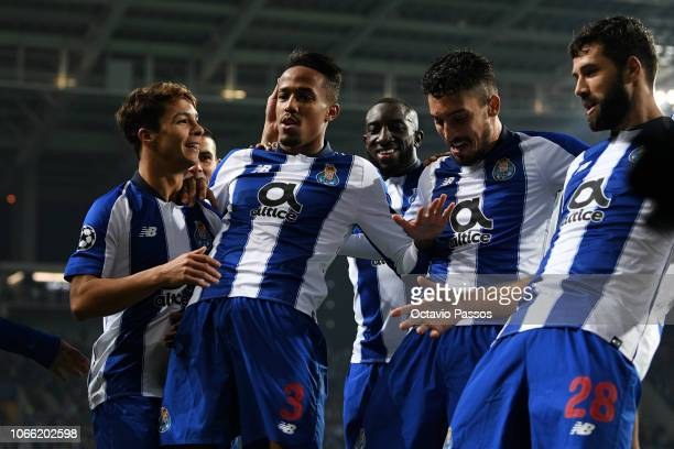 Eder Militao of FC Porto celebrates with teammates after scoring his team's first goal during the UEFA Champions League Group D match between FC...