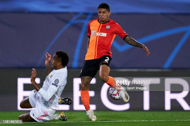 Eder Militao of Real Madrid battle for the ball with Dodo of Shakhtar Donetsk during the UEFA Champions League Group B stage match between Real...