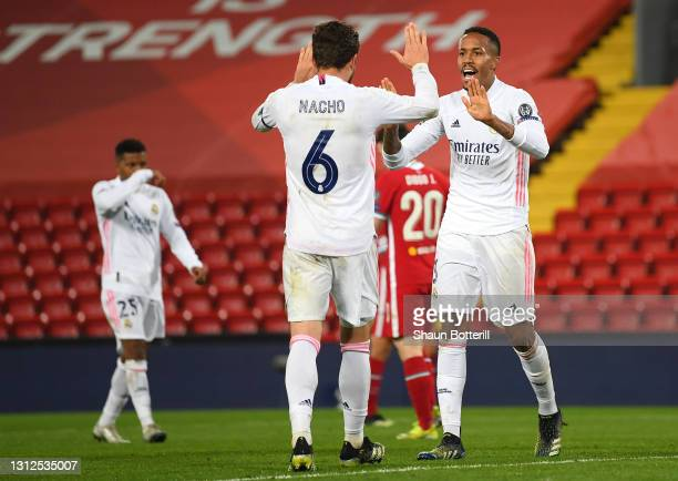 Eder Militao of Real Madrid celebrates victory with team mate Nacho following the UEFA Champions League Quarter Final Second Leg match between...